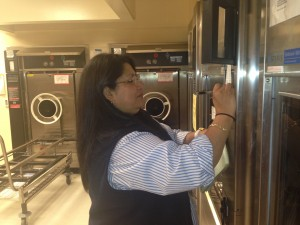 Ana Alvarado Lopez checking water usage at Byers Hall Glasswash facility
